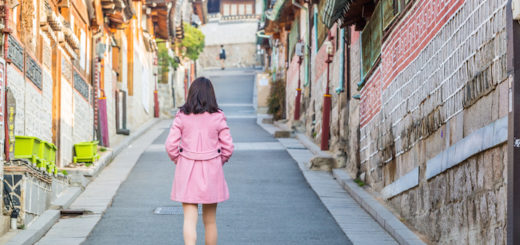 girl in pink coat in Bukchon neighbourhood in Seoul, South Korea
